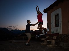 leap of faith (dedic. to Carol & Toni) (*BegoñaCL) Tags: boy girl old building car sunset jumping sky horizon bench begoñacl people couple