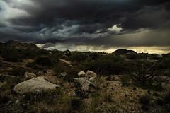 Desert storm (iatassi) Tags: rain clouds cloudsstormssunsetssunrises blackclouds rocks southwest arizona iatassi iatassiphotography canon5dmarkiv scottsdaleaz copyright
