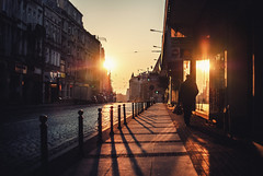 Personal Cinema; Święty Marcin (ewitsoe) Tags: peronalcinema cinematic street urban sunrise dawn morning man walking ewitsoe poznan poland winter silhouette mystery story words blog blogger storefront empty alone wandering soul atmosphere nikon d80 35mm polska europe