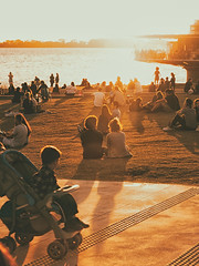 Here comes the sun (L'nort) Tags: child sunset nikon d700 lake dusk crowd people afternoon porto alegre
