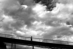 Coming down from the sky (pascalcolin1) Tags: paris13 homme man passerelle footbridge ciel sky nuages clouds descente descent bonnet cap lumière light ombres shadows photoderue streetview urbanarte noiretblanc blackandwhite photopascalcolin canon canon50mm 50mm