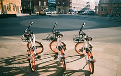 Mobikes (Jim Davies) Tags: vivitarultrawideandslim vivitar expired hardexpired kodak portra 160vc colourfilm 35mm film filmfilmforever analogue veebotique plasticcamera toycamera uws 2017 believeinfilm plastic compact 2018 oxford frideswidesquare ox11hp january mobike bike bikes bicycle rental transport cycling
