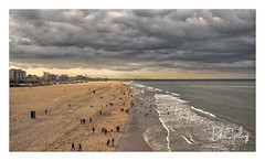 Who lost their balls? (Bob Geilings) Tags: sea shore clouds dramatic skyline sand netherlands people stroling boulevard