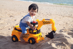 Asian boy play a toy of excavator with a sand (I love landscape) Tags: soil relax traveller travel driller indian japanese chinese thai thailand outdoor driver drive work kid skid worker job smile education asian asia sand beach family excavator construction truck box toddler play ground pit blue small cute caucasian outside summer person baby happy nature little childhood fun toy boy child
