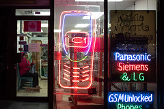 Night Call (cookedphotos) Tags: 2018inpictures toronto ontario canada ca canon 5dmarkiv streetphotography night light neon cellphone phone mobile woman talking sit door window store shop 365project p3652018