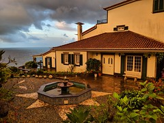 sunrise after the thunderstorm (ekelly80) Tags: azores portugal sãomiguel ribeiradastainhas fall october2018 sunrise airbnb sun view morning clouds sky thunderstorm rainymorning garden fountain cobblestones house tiles golden water ocean atlanticocean