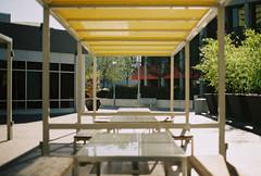 empty table (jayplorin) Tags: san jose california canon ae1 film tables buildings city urban kodak gold 200 35mm