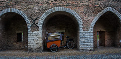2018 - Delft - Old City Wall (Ted's photos - For Me & You) Tags: 2018 cropped delft nikon nikond750 nikonfx tedmcgrath tedsphotos vignetting arches delfteastgate oostpoort delftoostpoort oostpoortdelft eastgatedelft bicycle bike brickwall brick wheels