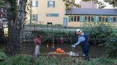 DSC02901  Halloween fishermen decorations along Delaware and Raritan Canal: Lambertville NJ (Lynn Friedman) Tags: lambertville newjersey usa outside day 08530 halloween decorations fishing pumpkins haybale delawareandraritancanal