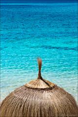 port de pollença (heavenuphere) Tags: portdepollença port pollença majorca balearicislands islasbaleares spain espana island europe beach parasol umbrella coast coastline mediterraneansea sea water blue 24105mm