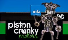 Piston Cranky Motors (Steve Taylor (Photography)) Tags: pistoncrankymotors mtaassured robot crank cog gear piston sign advert black blue green white metal newzealand nz southisland canterbury christchurch city shape