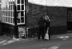 Don't Worry Mabel its not to painful (Bury Gardener) Tags: suffolk street streetphotography streetcandids snaps strangers candid candids people peoplewatching folks bw blackandwhite monochrome mono england eastanglia uk britain 2018 nikond7200 nikon angellane
