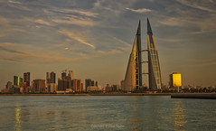 Bahrain World Trade Centre and Manama Skyline (Dave Sexton) Tags: manama bahrain bay world trade centre city skyline glass water reflections highrise skyscraper sunset golden hour dxo photolab on1 affinity photo pentax k1 2470mm f28 wide angle