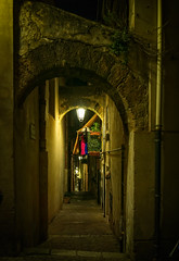 Stairs under two arches (Tiigra) Tags: cefalù palermo italy it 2018 architecture balcony cefalu lantern laundry light night passage plant portal rhythm road sicily stairs town wall arch