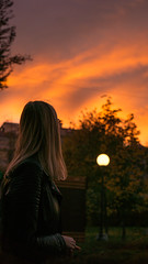Blond girl looking at a red sunset (Pudan416) Tags: sunset moscow girl woman sony a6000 autumn fall blond red sun orange sky clouds tree trees city urban street light new flickr lightroom