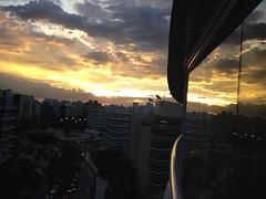 ano novo  Riviera 2013 (ligiavcrispino) Tags: pôrdosol céu sky sunset reflection reflexo janela window edifícios prédios buildings