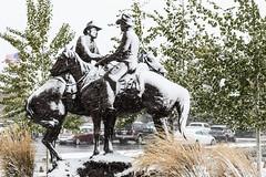Old Friends Greet Each Other On A Snowy October Day (wyojones) Tags: wyoming cody buffalobillcenterofthewest snow snowstorm snowfall sticky wet sculpture statue herbmignery codeofthewest bronze cowboys horses handshake
