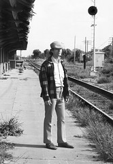 Mike Robbins is seen standing on the former ACL east-west main line platform at the Union Depot in Plant City, Florida, on New Years Day, January 1, 1975 (alcomike43) Tags: plantcityflorida atlanticcoastline seaboardairline acl sal station depot platform plantcityuniondepot railroads trains passengertrains freighttrains diamond conventionaljointedsectionrail rails ties rightofway mainline roadbed ballast platformtrack tracks spikes tieplates blocksignal diamondprotectionsignal railwayexpressagency mikerobbins photo photograph bw blackandwhite old historic vintage classic