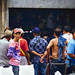 Men Watching Muai Thai in the Street