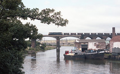 CROSSING THE WEAVER (Malvern Firebrand) Tags: brush class 47 heads across river weaver frodsham circa may 1983 47xxx class47 cheshire water boats outdoors rural countryside scenic bridge tree freight locomotive transportation trains railways vehicles mgr wagons motorway