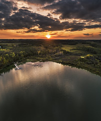 Sunset at The Bay (Terry L Richmond) Tags: sunset water river lake reflection nature landscape sky sun dawn evening beach tree outdoor noperson man reservoir surfing background cloud horizon outdoors clouds loch walking storm sunrise wave atmosphere view fog dusk body fall sunlight ocean hill scenic bank large waterresources rain wetland flock afterglow dji drone elevated