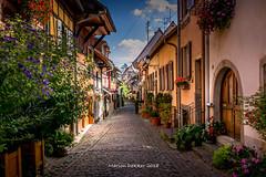 Eguisheim (AMSDekker) Tags: soe supershot france alsace eguisheim street village sky blue halftimberedhouses houses colouredhouses