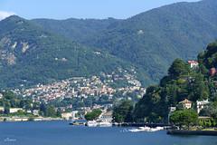 Villa Geno (lamnn92) Tags: como lake lagodicomo waterfountain mountains alps housesonthehillside trees boats water blue sky view skyline 3x2format promenade travel fz1000