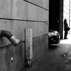 Going out of the wall (pascalcolin1) Tags: paris13 homme man mur wall voiture car sortant exit tuyau hose tube photoderue streetview urbanarte noiretblanc blackandwhite photopascalcolin 50mm canon50mm canon