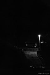 Now With 50% Added Blackness! (redfibres) Tags: ef70200mmf4lisusm canon 80d blackwhite bw black beach filey lights night dark autumn ramp concrete