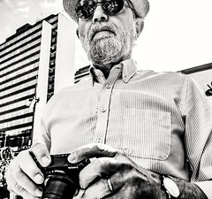 Close to the shooter... (mikeback-streetphotography) Tags: streetstyle streetphotographer stockholm streetarteverywhere streetportrait streetphotographystreet streetlife streetphoto streetartistry streetphotography street streetphotographers streetart urban bnw monochromatic monochrome mono blackwhite black blackandwhite blackandwhitephotography