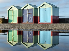 October trio (sunset1uk) Tags: beachhuts reflections reflection puddle water promenade brighton hoveseafront hovebeach hove eastsussex englanduk