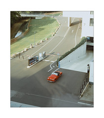 Escaping with Style (Thomas Listl) Tags: thomaslistl color perspective red car oldcar oldtimer grass muted topography mundane layer light sunlight garage 50mm