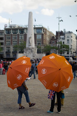 Parasol dam LR (Jerome Kroidner) Tags: amsterdam netherlands damsquare umbrella orange duo street streetphotography