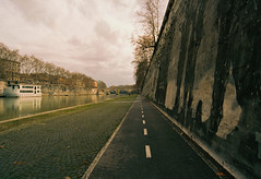 Tiber Cyclepath (thomas100) Tags: rome italy nikon fm3a kodak ektar 100 europe citylife river tiber rivertiber cyclepath cobbles wall clouds