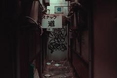 Somewhere in Osaka (Laser Kola) Tags: streetphotography smallalley dirtyalley japan osaka abandoned 2014 laserkola lasseerkola tagged streetart bladerunner dystopian dystopia fujifilm x100s cinematic cinematographer cinematography exploringthecity explorejapan steampunk streetview narrowalley 大阪市 urbanphotography architecture