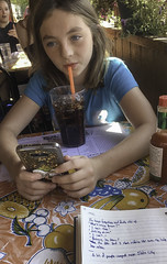 Drinking and texting (Trail Image) Tags: abbott brennaabbott drinking restaurant texting trudyskitchen writing