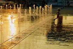 liquid gold (claudia 222) Tags: sunset amsterdam water haarlemmerplein noctilux golden boy yellow happy 50mm