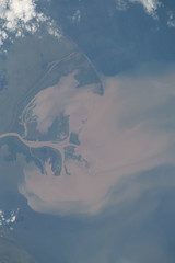 Muddy River Delta (sjrankin) Tags: 12october2018 edited nasa iss iss056 iss056e200238 river delta sediment ocean muddy clouds centralamerica