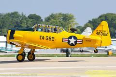 N5451E - 1949 build North American T-6G Texan, rolling for departure on Runway 27 at Oshkosh during Airventure 2018 (egcc) Tags: 168496 493382 49382 airventure airventure2018 e16114 eaa harvard kosh lightroom n5451e northamerican osh oshkosh steele t6g ta382 texan usairforce usaf