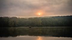Autumn morning (BalintL) Tags: lake water morning haze hazy sunrise clouds orange reflection boat fishing autumn forest trees rural nature sky