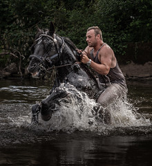 Emerging the River (Swirly_Magnolia) Tags: appleby horse fair 2018 gypsy gypsies travelers horses water river spray man wet ride riding stream gallop charging dramatic nikon tamron zoom lens swirly magnolia demonic strong charge