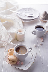Tasty sweet macarons and coffee cup on white wooden background. Cristmas concept lazy morning, warm winter mood (lyule4ik) Tags: coffee cake cup macaron food breakfast dessert macaroon pink top view pastel overhead french colorful mug sweet gourmet bakery brown cafe calories tasty good morning card lifestyle white color capuccino yellow green vanilla chocolate france assorted assortment bake biscuit candy confection confectionery cookie cream cuisine delicate delicious lemon pastry pistachio