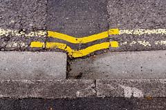 bent (amazingstoker) Tags: double yellow lines new road basingstoke amazingstoke basingrad hampshire kerb repair wabi sabi bent tarmac