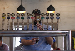 Bobby Craig, 29, from Hazeville, North Carolina, fills a beer glass. Craig has been the Tasting Room Manager since opening day in May, 2017.