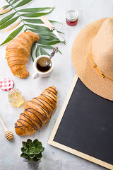 Traveled breakfast with croissants, honey, jam and berries on the trip. Background of a chalkboard, palm leaf and hat on a concrete background with space under the text. (lyule4ik) Tags: croissant breakfast food fresh delicious french closeup pastry snack bread dessert background bakery tasty roll brown bun crust meal morning sweet table white butter cuisine eat gold coffee golden wooden bake buttered buttery cafe freshness homemade yummy drink isolated continental color dough object traditionally chocolate nutrition jam traditional crescent
