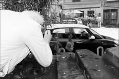 (Two Birds, One Stone) (Robbie McIntosh) Tags: leicam9p leica m9p rangefinder streetphotography 35mm leicam autaut candid strangers leicasummilux35mmf14i summilux35mmf14i summilux man woman flash shutterdrag draggingtheshutter blackandwhite monochrome bw animal hen