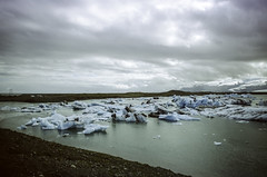 Jökulsárlón (hiphopmilk) Tags: copyright©jaredyehwooehmoehfilms nikonfm2n nikonfm2 nikon fm2 35mm 135film film analog analogue kodak nikkor hiphopmilk north europe nordic iceland glacier iceberg lagoon vatnajökull ice sky cloud lake jökulsárlón glacial icebergs breiðamerkurjökull