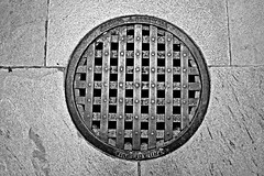 Manhole Cover (Throwingbull) Tags: eastern state penitentiary jail prison incarceration incarcerated inmate inmates philadelphia pa pennsylvania history historic cell cells holding samuel j creswell manhole cover black white monochrome gritty