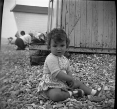 Baby at the seaside (vintage ladies) Tags: blackandwhite vintage people photograph 60s baby sitting seaside beachhut beach portrait