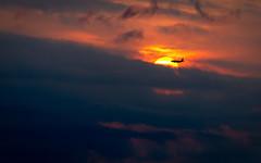 Sunset Flight (ep_jhu) Tags: sun aircraft washington sunset 7d cloudy jet hazy avion sol canon dc airplane clouds